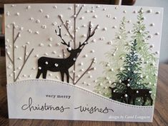 I know Christmas is over, but I wanted to share the card I made for my husband this Christmas. I made an outdoor winter scene with a lot of snow. I started by stamping some evergreen trees with a stam