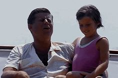 John F. Kennedy and daughter Caroline, 1963.