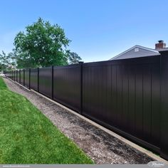 Black PVC Vinyl Low Maintenance Privacy Fence Panels from @illusionsfence is a perfect good neighbor fence idea for your home or business. #fenceideas #black #pvc #vinyl #fence #backyardideas #homedecor
