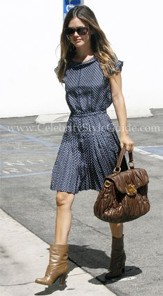 #RachelBilson #Celebrity Doesn't that dress look so vintage? Very cute. I can see it being very proper 1950s housewife with pearls and black heels and maybe even little white gloves. The shoes toughen it up, but I'm not sure I like them.