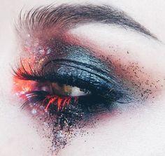 Black and red grunge eye makeup. Dramatic editorial make up.