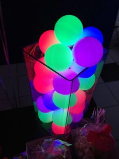 Glow sticks put into neon balloons, blown up and tied. Maybe put in the pool??
