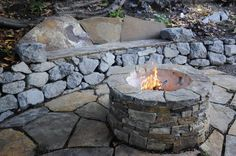 stone terrace with built in bench in retaining wall, stone firepit