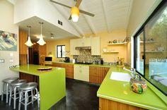 Choosing a bright color for your kitchen cabinets is a big commitment.  Be sure you will love it 10 years from now. Otherwise, go neutral and add colorful accessories.  #homedecor #kitchens.
