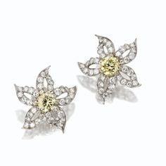 Pair of fancy colored diamond and diamond flower earclips, Van Cleef & Arpels, New York, 1952 | Lot | Sotheby's
