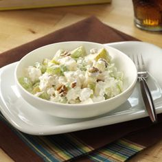 Pear Cottage Cheese Salad Recipe -Perfect any time, this quick-fix snack makes a great pack-along lunch, too!  —Jeannie Thomas, Dry Ridge, Kentucky