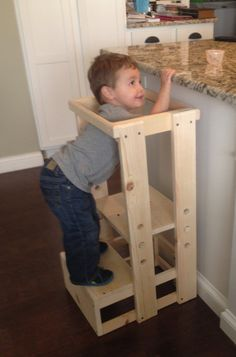 This Childs Kitchen Helper Step Stool which our grandson fondly calls his Tot Tower stands 32 tall, 15 1/2 inches wide and the base is 17 1/2 deep. This is perfect for your toddler as they shadow you in their curiosity to learn - in the kitchen, at the bathroom sink, dads workbench or anywhere to get your child to counter height safely. It weighs in at only 14 pounds and is easy for your toddler to move. There are three height adjustments so as your child grows taller, the standing board…