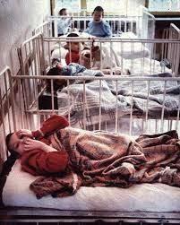 Image result for Romanian orphanage cots cribs