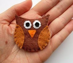 Fun to make!  http://bugsandfishes.blogspot.com/2010/01/how-to-felt-owl-brooch.html