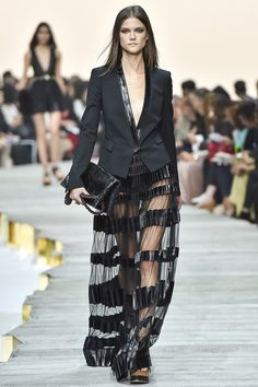 Roberto Cavalli Spring 2015. See the collection on Vogue.com.