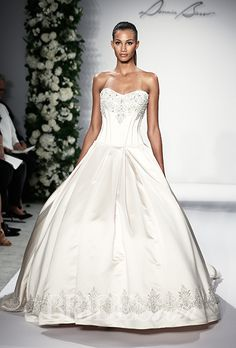Brides.com: Dennis Basso for Kleinfeld - 2015%0AStyle 14048, strapless satin rose gold ball gown wedding dress with a sweetheart neckline and beaded details, Dennis BassoPhoto: Thomas Iannacone