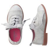 Dress up any outfit with this updated classic. Heeled oxfords are pepped up with metallic color and glitter toe accent.