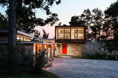 Stonington Residence: A Contemporary Home Update With a Large Stone Wall