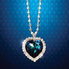 The Heart of the Ocean, also known as Le Cœur de la Mer, is the fictional heart-shaped blue diamond which was originally owned by Louis XVI and cut into a heart shape after the French Revolution. Many pirates searched for this pendant, but now it can be yours and this can your gift for valentines day which will express your love for her . The large, turquoise colored artificial sapphire is set among 26 faux diamonds.