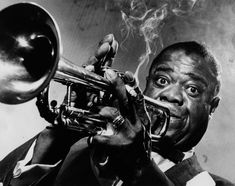 Louie Armstrong  God he's great. Saw him at the Newport Jazz festival in mid-to-late 70's and got unbelievable photos of him with his cheeks blown out ...
