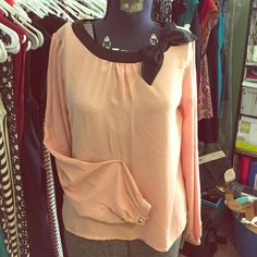 Adorable holiday blouse Insanely adorable blouse. Nude-pink tone, black collar with bow. Keyhole closure in back with gold pyramid stud buttons (also at wrist) Just super cute...pair with skater skirt or skinnies for a great holiday outfit!!! one clothing Tops Blouses
