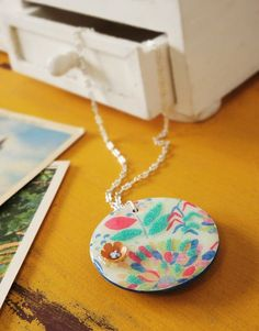 Make a floral pendant using Mod Podge, Dimensional Magic and Martha Stewart microbeads.