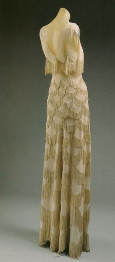 Vionnet = Really like this dress, but I'd like it even more in a different color. :o)