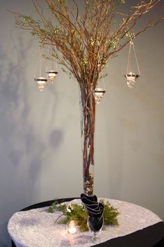 Creative wedding centerpiece ideas. I just love the whole bundle of branches thing.