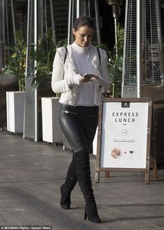 Texting someone special? Jodi separated from her husband Braith Anasta in December...