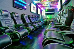 """The Rockin' Gamin' Theatre! Equipped with 10, awesome, 50"""" HD Tvs and 20 XRocker Gamin' Chairs"""