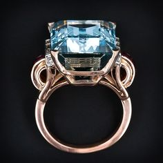 A stunning cocktail ring by the eminent French and American jewelry firm Van Cleef & Arpels, circa 1935-1940s. A serene pastel blue, emerald cut Aqua, weighing approximately 17.00 carats.
