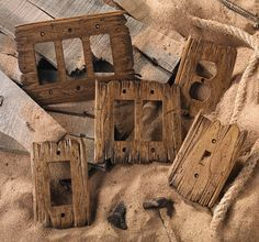 Rustic Switch Plates - Old West style, shown here in color Rustic Barn. Hand-carved www.rusticwoodstudio.com