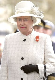 Queen Elizabeth, 2004. A gift from the French Order of Liberation in 1990. The Coral Rose brooch.