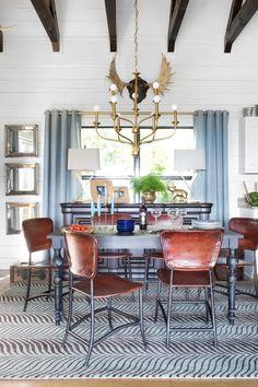 plank walls, leather chairs, brass chandy (minka-lavery)