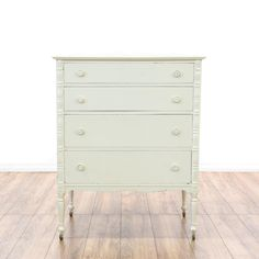 This cottage chic dresser is featured in a solid wood with a fresh white paint finish. This dresser has 4 spacious drawers, carved spindle side trim and small rolling wheel feet. Perfect for brightening up a room! #shabbychic #dressers #talldresser #sandiegovintage #vintagefurniture