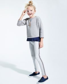 J.Crew girl's ruffle hem sweatshirt in heather athletic grey, everyday leggings in chevron glitter dot, and glitter slip-on sneakers.