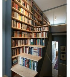 Awesome bookshelf stairs how cool is this!!?? :) :) #readbooks #bookshelves #bookstairs