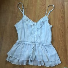 Baby doll tank top Very cute. The size is a large but fits like a medium in my opinion. Tops Tank Tops