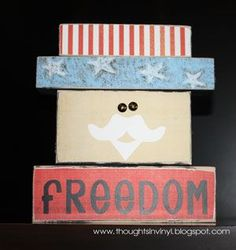 Stackable blocks made with vinyl, nails and scrapbook paper... brilliant!