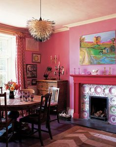 Save your plates, build a  fireplace...love it all...Especially the art work above the fireplace....!