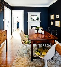 first, i enjoy the black wall. then, i like said black wall with wood block floor. in addition to those, i like the table and chairs. so to sum up, i like it all.