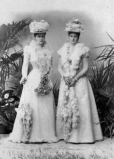 Alexandra and sister Ella demonstrate late 1890's fashion with A-line skirts, mildly puffed sleeves, and shallow vee waists and waist bands.