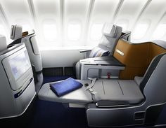 The only way to travel 13-15 hrs to another country...Business Class.    Fancy - Lufthansa Business Class Cabin