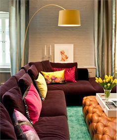 Colorful Living Room by David Howell - rich aubergine sofa is accented with a fresh color combo of pink and yellow, seen in the throw pillows. ==>http://www.homeportfolio.com/SlideShow/pink-and-red/david-howell#
