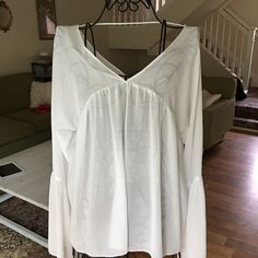 Urban Outfitters Honey Punch White Flowy Shirt M Super cute boho White flowy shirt in size medium.  But could easily fit a small and maybe a large depending on the fit you want.  Would be great with a tank or bralette under as it is sheer.  Great over a swimsuit also! Pair with jeans or shorts! Super cute! Great condition! Ask any questions! Black shirt is just for modeling purposes.  Urban Outfitters Tops