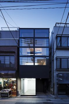 This narrow house on a high street in Tokyo by Apollo Architects & Associates features a glazed ground-floor gallery.