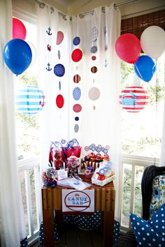 While there will certainly not be a candy bar, I like the circle paper garlands