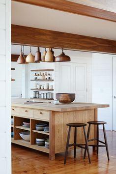 layered wood tones kitchen island | modern shaker beach house tour on coco kelley