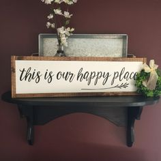 This is our happy place. This lovely sign is just what youve been looking for to hang or place in your familys favorite room! White background and black lettering with a stained frame. Measures approx 26x8. I can do other colors if you would like. Please convo me before purchasing if you would like to change anything. If you request color changes it may add a few days to the shipping time. There is NO vinyl on any of my signs, the finished product is a fully handmade and handpainted sign…