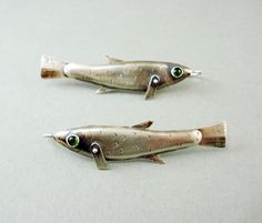 Rocket Fish Earrings with Green Onyx Eyes by jewelrycollectibles on Etsy https://www.etsy.com/listing/172316387/rocket-fish-earrings-with-green-onyx