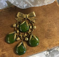 Goldtone Bow and Brass Chain and Bells Green Lucite Brooch Pin Whimsical and Sweet