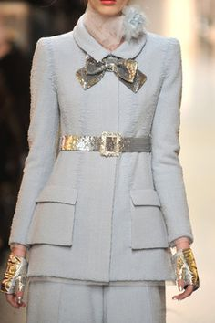 Chanel. This is one of my favorite suits from this particular show. Classic.