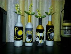 My version of the LOVE yarn wrapped wine bottles and pearl embellishments and rolled fabric flowers.