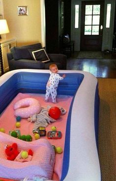 inflatable pool as a baby play area.  Genius Why did we never think of this???!