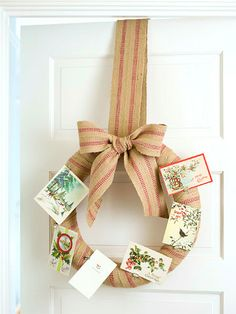 Christmas Card Wreath:   It's easy to transform a simple wreath into a Christmas card display. Wrap a straw wreath with upholstery webbing (available at fabrics stores), using small sewing pins to secure. Tie a bow at the top and loop a length through the back to hang. If the recipient loves vintage collectibles, attach antique Christmas cards to the wreath with binder clips. Or include a small tin of clips with the wreath so the recipient can add their own cards as desired.